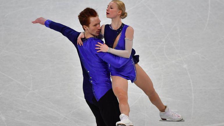 Евгения ТАРАСОВА и Владимир МОРОЗОВ взяли бронзу. А Наталья Забияко и Александр Энберт из-за ошибок заняли лишь 12-е место. Фото AFP