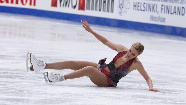 31 марта. Хельсинки. Одно из трех падений Анны ПОГОРИЛОЙ во время произвольной программы. Фото AFP