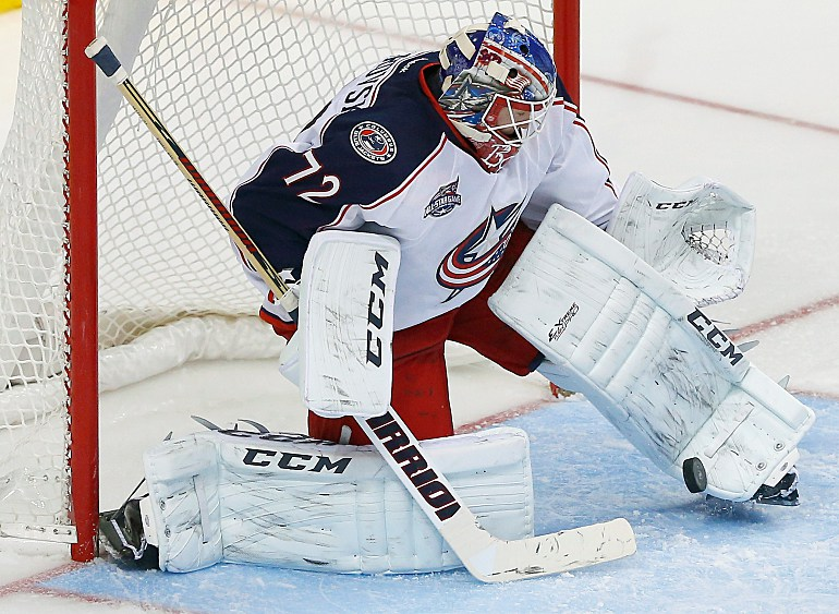 tries to move around ottawa senators goaltender robin lehner, of sweden, during the team shootout of an nhl hockey