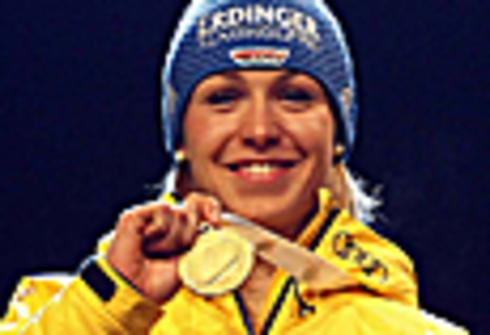 3 марта 2012 г. Рупольдинг (Германия). Чемпионат мира. Магдалена Нойнер завоевывает золотую медаль в спринте. Фото REUTERS