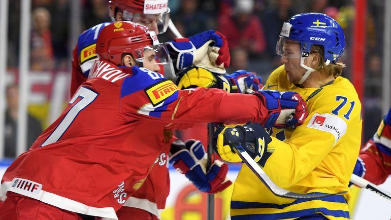 Вадим ШИПАЧЕВ (слева) потолкался со шведами. Фото AFP