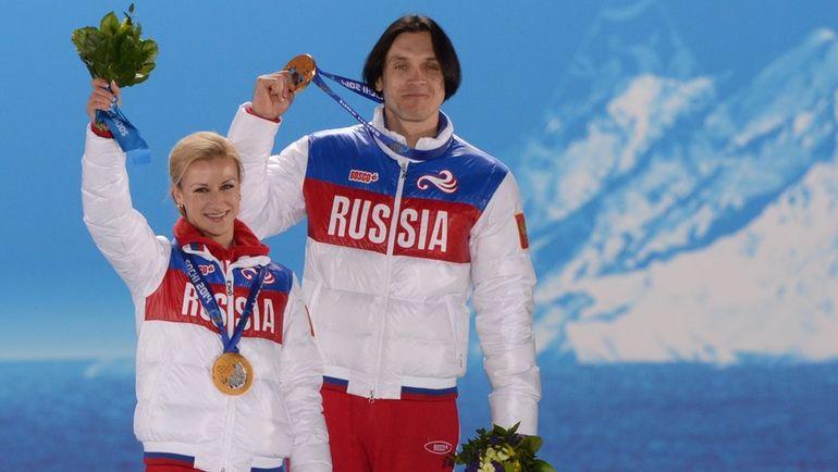 2014 год. Сочи. Максим ТРАНЬКОВ (справа) и Татьяна ВОЛОСОЖАР - олимпийские чемпионы. Фото AFP