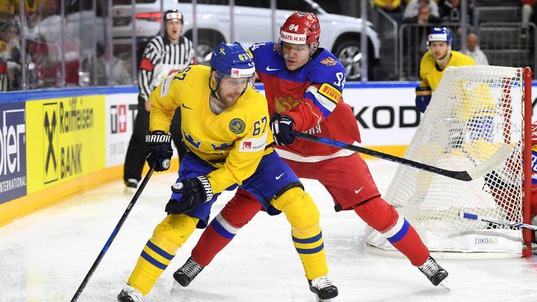5 мая. Кельн. Швеция - Россия - 1:2 Б. Андрей МИРОНОВ (справа) обороняется против Линуса УМАРКА. Фото AFP