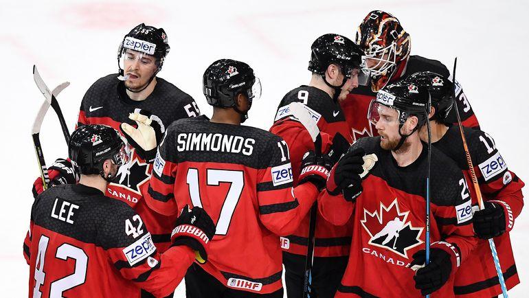 """Четверг. Париж. Канада – Франция – 3:2. """"Кленовые листья"""" празднуют победу. Фото REUTERS"""