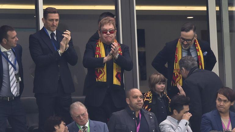 Элтон ДЖОН (в центре). Фото Reuters