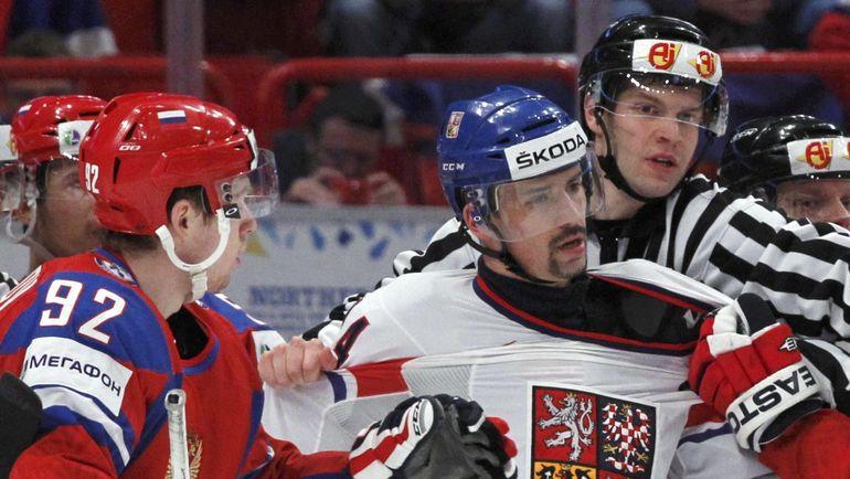 Евгений КУЗНЕЦОВ (№92) и Томаш ПЛЕКАНЕЦ. Фото Reuters