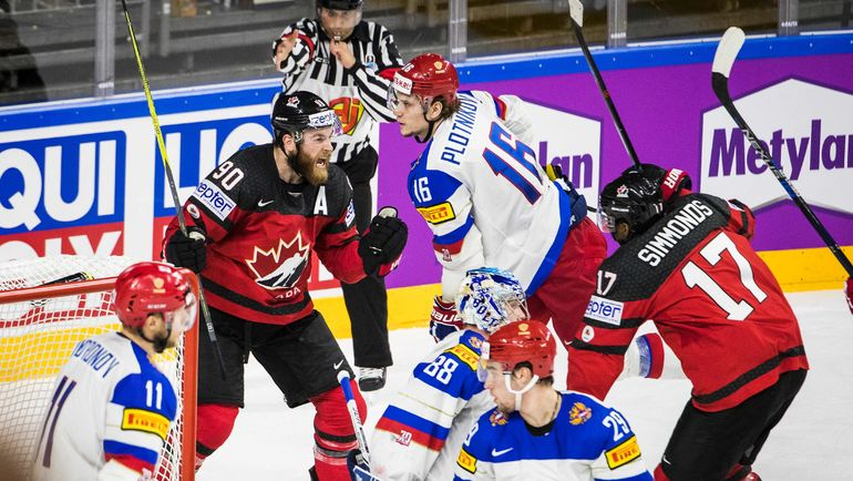 Сегодня. Кельн. Канада - Россия - 4:2. Райан О'РАЙЛЛИ (№90) и Уэйн СИММОНД (№17) празднуют победный гол. Фото Reuters