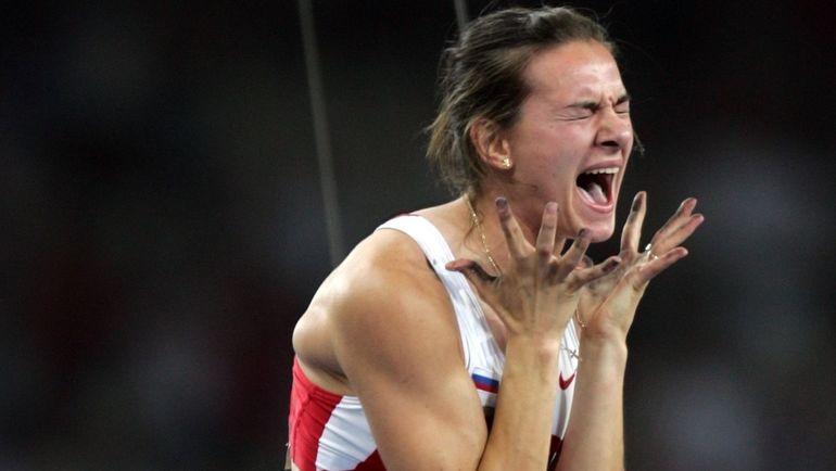 24 августа 2004 года. Афины. Елена ИСИНБАЕВА впервые выиграла Олимпийское золото. Фото Григорий ФИЛИППОВ