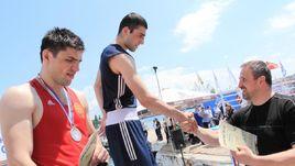 Георгий КУШИТАШВИЛИ (в центре) не сможет выступить на чемпионате Европы по политическим причинам.