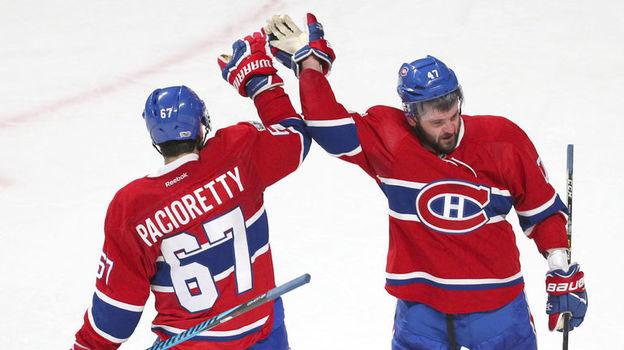 Продолжит ли Александр РАДУЛОВ (справа) карьеру в НХЛ? Фото USA Today