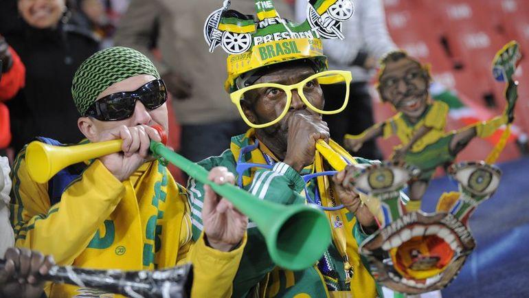 Поклонники сборной ЮАР на Кубке конфедераций-2009. Болельщики не всегда заполняли стадионы даже бесплатно. Фото AFP