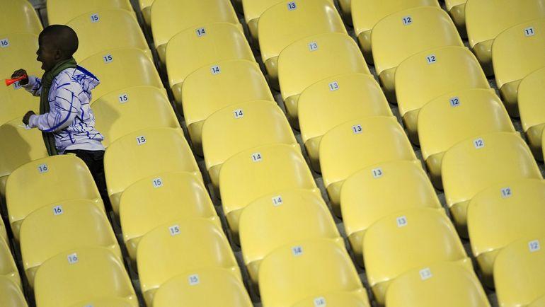 Ребенок на трибунах арены Кубка конфедераций-2009. Фото REUTERS