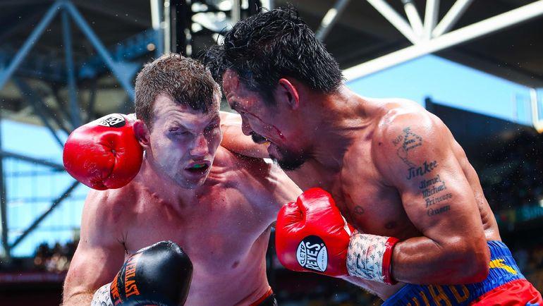 Джефф ХОРН (слева) сенсационно победил Мэнни ПАКИАО решением судей. Фото AFP