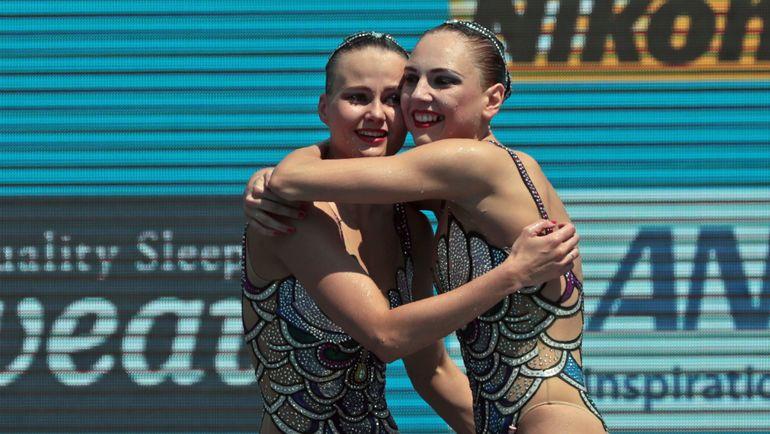 Александра ПАЦКЕВИЧ (слева) и Светлана КОЛЕСНИЧЕНКО. Фото AFP