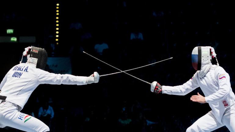 Сегодня. Лейпциг. Павел СУХОВ (справа) против Андраса РЕДЛИ в поединке за 3-е место. Фото AFP