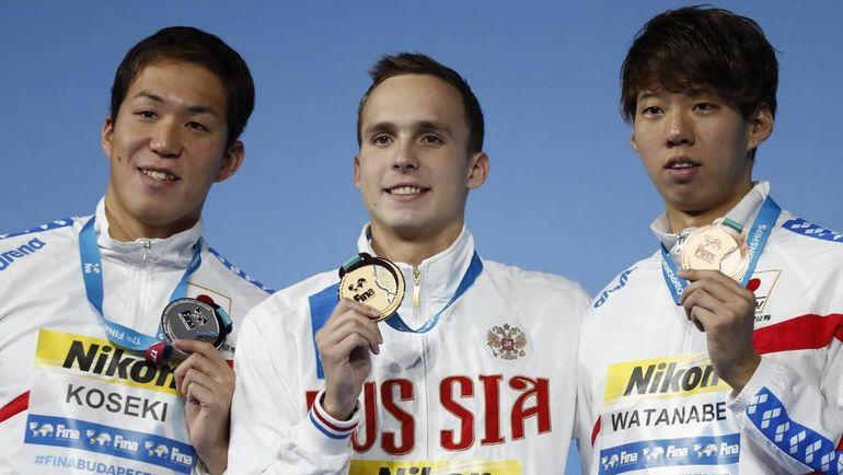 Ясухиро КОСЕКИ (слева), Антон ЧУПКОВ (в центре) и Иппей ВАТАНАБЕ. Фото AFP