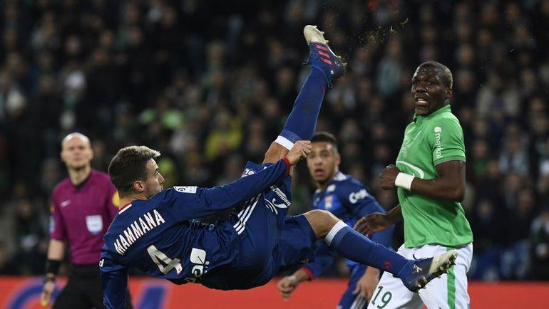 Удар через себя в исполнении Эмануэля МАММАНЫ. Фото AFP