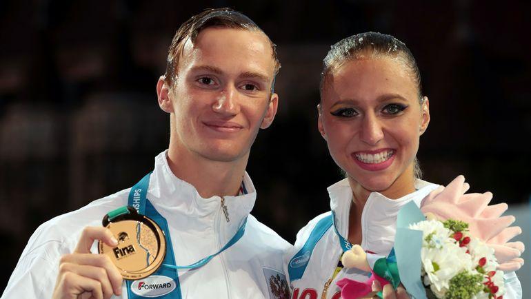Александр МАЛЬЦЕВ и Михаэла КАЛАНЧА. Фото AFP