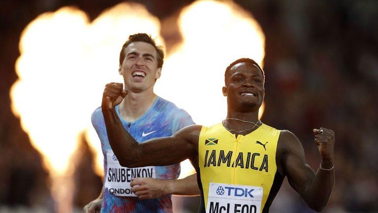 Сергей ШУБЕНКОВ (слева) и победивший в забеге ямаец Омар МАКЛАУД. Фото REUTERS