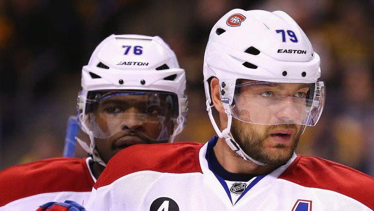 Андрей МАРКОВ (справа) и Пи. Кей. СУББАН. Фото AFP