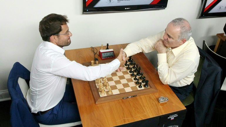 Гарри КАСПАРОВ (справа) и Левон АРОНЯН. Фото AFP