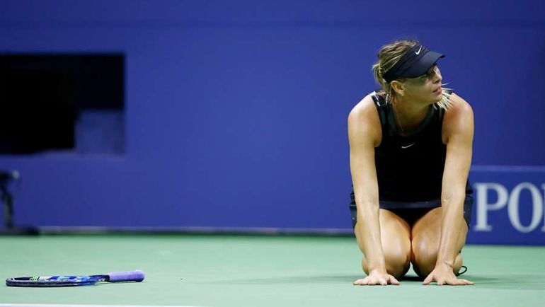 Реакция Марии ШАРАПОВОЙ после победы над Симоной Халеп. Фото AFP