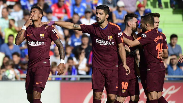 """Суббота. Хетафе. """"Хетафе"""" - """"Барселона"""" - 1:2. 84-я минута. Победу каталонской команде принес гол ПАУЛИНЬЮ (слева). Фото AFP"""