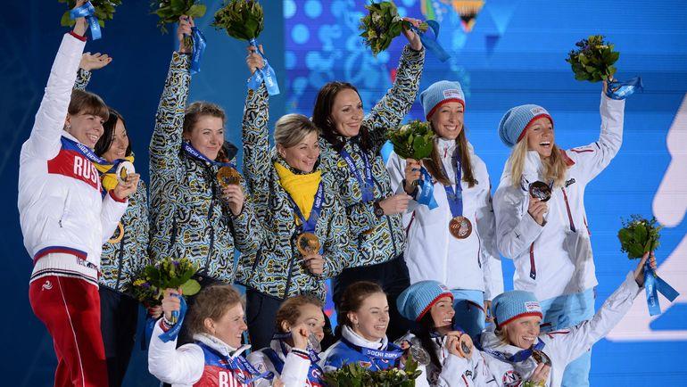 Женские сборные России, Украины и Норвегии по биатлону - на пьедестале Сочи-2014. Увидим ли мы спортсменок рядом в Пхенчхане? Фото AFP