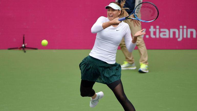 Сегодня. Тяньцзинь. Мария ШАРАПОВА обыграла Магду Линетт и вышла в четвертьфинал турнира. Фото AFP