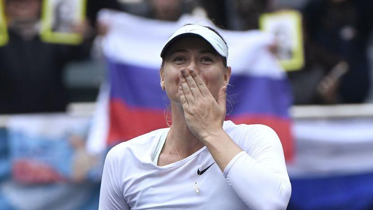 Мария ШАРАПОВА празднует победу на турнире в Тяньцзине. Фото AFP