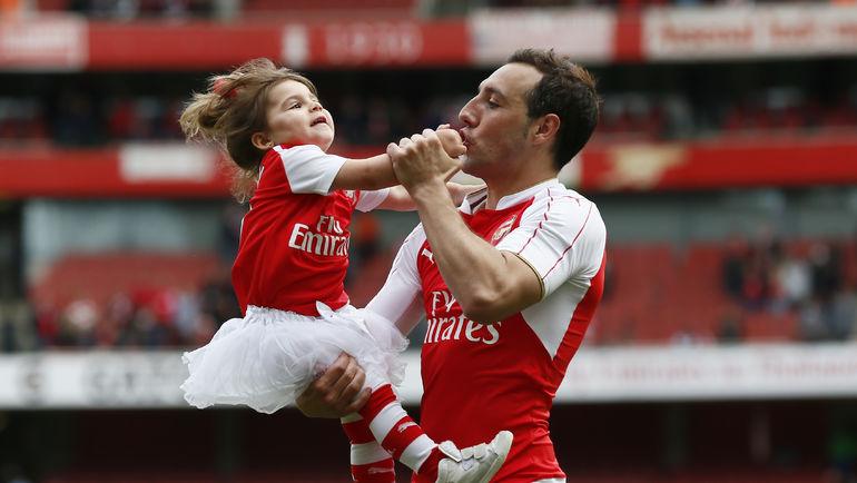 САНТИ КАСОРЛА с дочерью. Фото Reuters