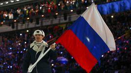 7 февраля 2014 года. Сочи. Александр ЗУБКОВ с флагом России на церемония открытия Олимпиады.