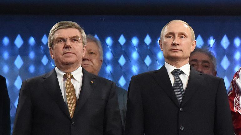 23 февраля 2014 года. Сочи. Президент России Владимир ПУТИН (справа) и глава МОК Томас БАХ на церемонии закрытия Олимпиады. Фото AFP
