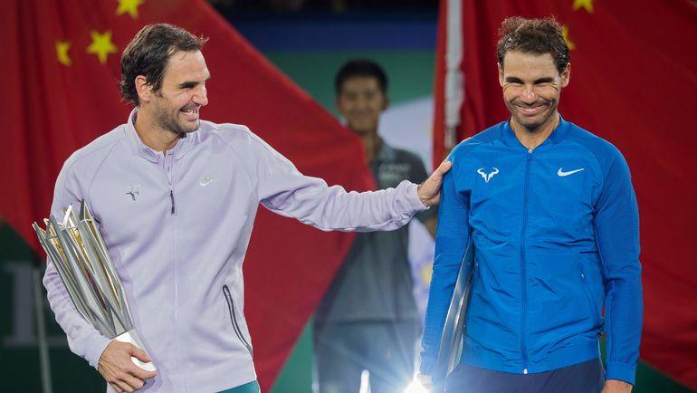 Роджер ФЕДЕРЕР (слева) и Рафаэль НАДАЛЬ. Фото AFP