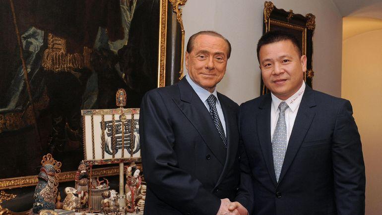Сильвио БЕРЛУСКОНИ (слева) и Ли ЮНХУН. Фото AFP