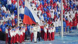 23 февраля 2014 года. Сочи. Российский флаг на церемонии закрытия Олимпиады.