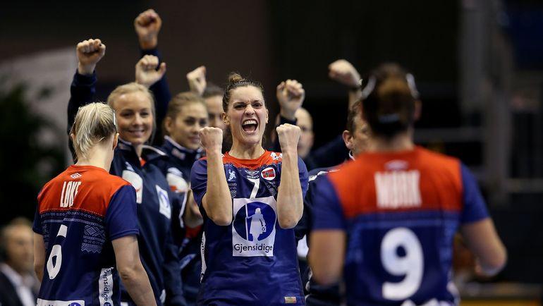 Игроки сборной Норвегии празднуют победу. Фото AFP