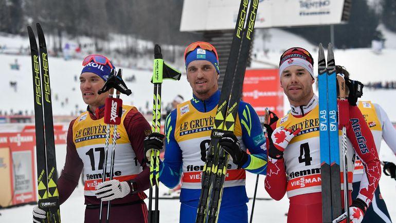Сегодня. Валь-ди-Фиемме. Андрей ЛАРЬКОВ (слева) с Алексеем ПОЛТОРАНИНЫМ (в центре) и Алексом ХАРВИ. Фото AFP