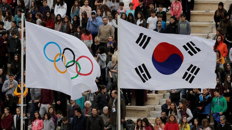 Флаги МОК и Кореи. Фото REUTERS