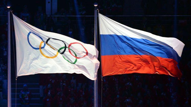 Когда флаг России вернется на стадионы Олимпиады в руках наших спортсменов? Фото AFP