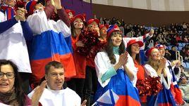 Флаги России есть на Олимпиаде! Как болеют за наших на фигурном катании