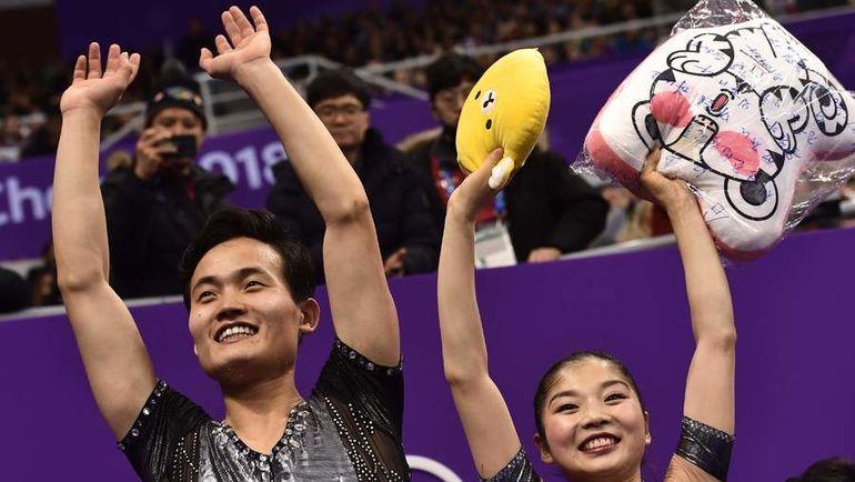 Ём Тхэ Ок и Ким Чу Сик. Фото AFP