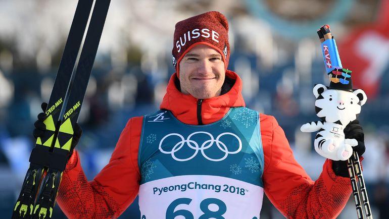 Сегодня. Пхенчхан. Дарио КОЛОНЬЯ после победной индивидуальной гонки Олимпиады. Фото AFP