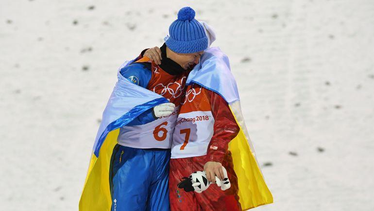 Илья БУРОВ (№ 7) и олимпийский чемпион Александр АБРАМЕНКО (№ 6). Фото Reuters