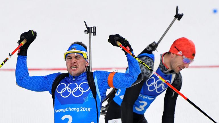 Арнд ПАЙФФЕР уступил на финише Доминику ВИНДИШУ и сборная Германи осталась без медали в смешанной эстафете. Фото REUTERS