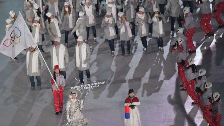 9 февраля на церемонии открытия Игр в Пхенчхане российская делегация прошла под олимпийским флагом. Что будет 25 февраля на закрытии? Фото AFP
