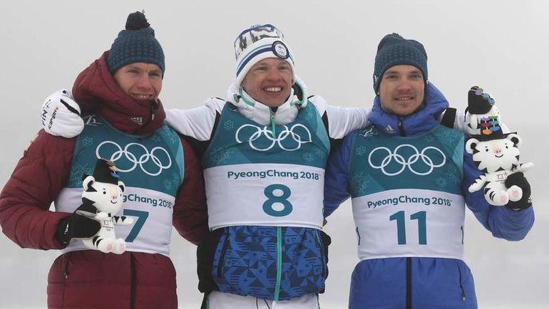 Суббота. Пхенчхан. Александр БОЛЬШУНОВ (слева), Иво НИСКАНЕН (в центре) и Андрей ЛАРЬКОВ. Фото AFP