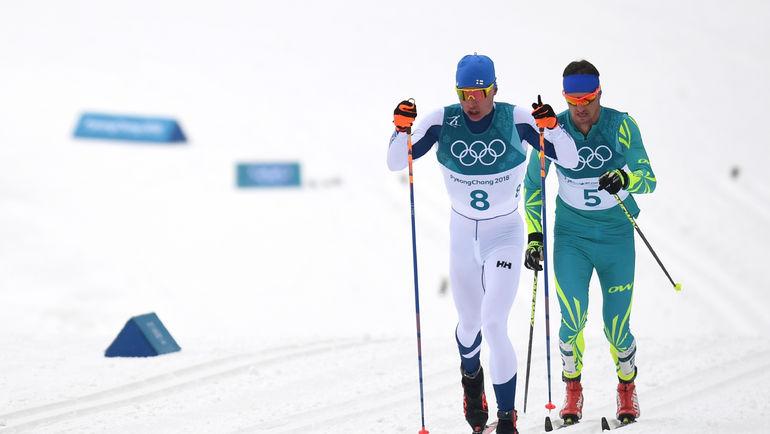 Алексей ПОЛТОРАНИН (справа) идет за Иво НИСКАНЕНОМ. Фото AFP