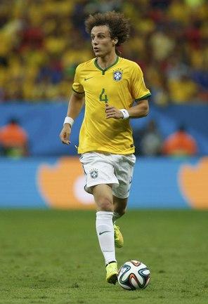 Защитник сборной Бразилии Давид ЛУИЗ Фото Reuters