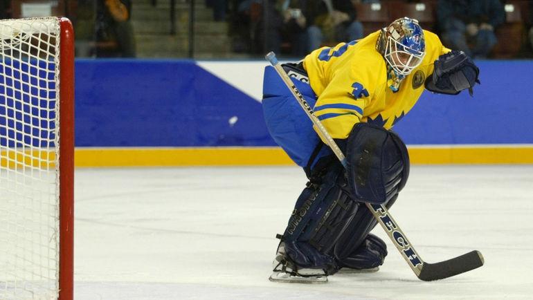 20 февраля 2002 года. Солт-Лейк-Сити. Швеция - Белоруссия - 3:4. Томми САЛО пропускает шайбу на последних минутах третьего периода. Фото REUTERS